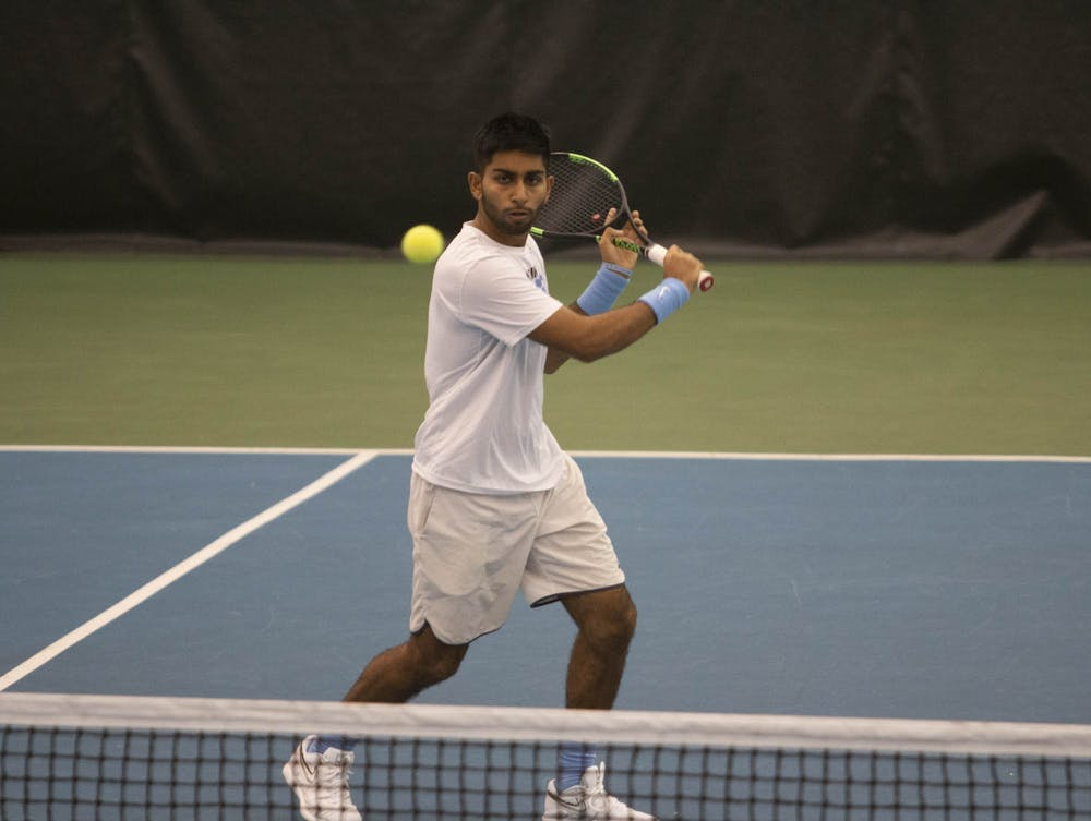 <p>UNC first-year Anuj Watane gets ready to return his opponent's serve on Saturday, Feb. 1, 2020 at the Cone- Kenfield Tennis Center. UNC defeated Illinois 4-0.&nbsp;</p>