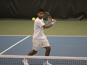 UNC first-year Anuj Watane gets ready to return his opponent's serve on Saturday, Feb. 1, 2020 at the Cone- Kenfield Tennis Center. UNC defeated Illinois 4-0.