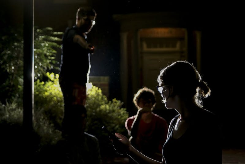 A photo illustration recreates a catcalling incident in front of Spencer Residence Hall.
