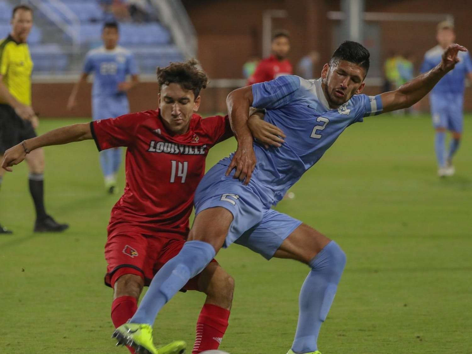Senior Mauricio Pineda (2) fights for the ball during the game against Louisville on Friday, Oct. 25, 2019. UNC lost to Louisville 0-1.