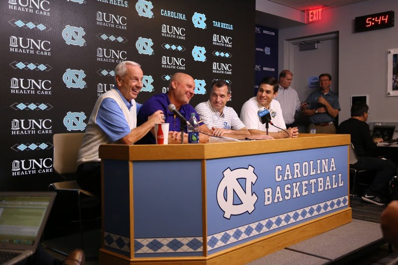 Roy Williams, Jeff Lebo, C.B. McGrath and Wes Miller sit squished in press conference after the Disaster Relief Jamboree.