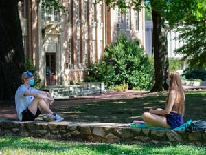 Students enjoy the outdoors while being social distant at Polk Place on Sunday, Sept. 6, 2020.