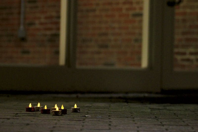 Students placed candles to mark the spot where Demitri Allison fell outside of Morrison Residence Hall on Wednesday.