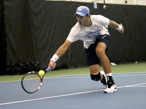 Junior Brayden Schnur returns a ball in No. 7 UNC Men's Tennis team's victory over No.5 Oklahoma 4-3 Sunday afternoon.