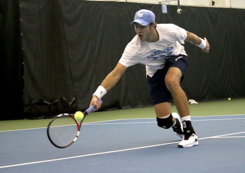 Junior Brayden Schnur returns a ball in No. 7 UNC Men's Tennis team's victory over No.5 Oklahoma 4-3 Sunday afternoon.