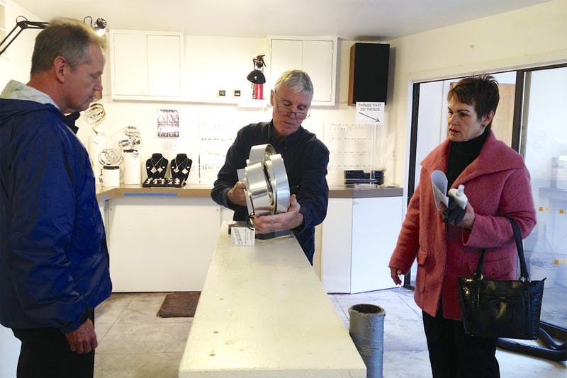 Chapel Hill residents Bill (left) and Kathy Jones complete their purchase of a top-end Dan Murphy sculpture.