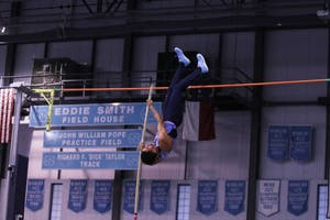 Sophomore Liam Dixon competes in the pole vault during the Dick Taylor Carolina Cup on Jan. 13 in Eddie Smith Field House.