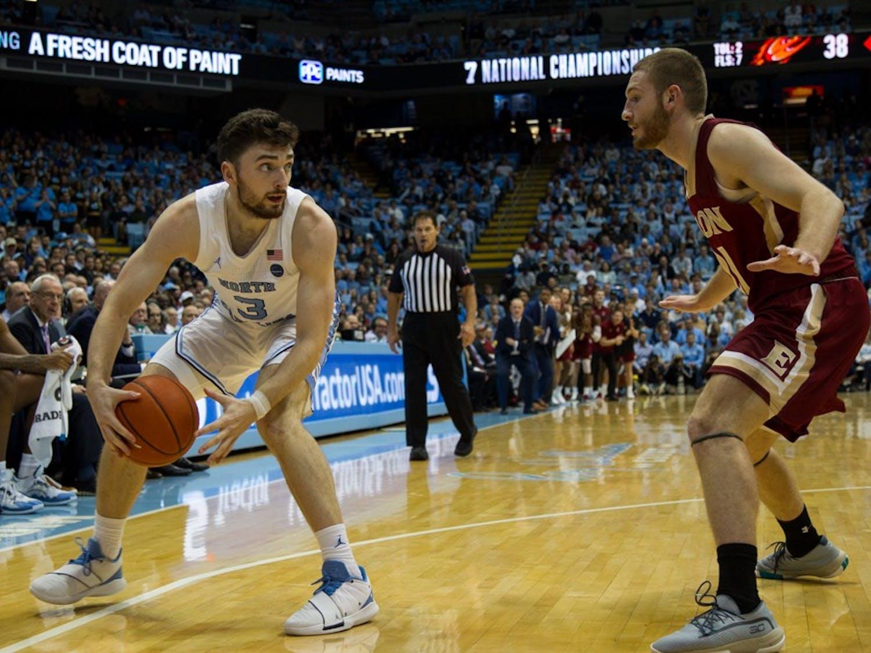 Junior guard Andrew Platek (3) keeps ball from opposing player in in basketball game against Elon University on Thursday, Nov. 20, 2019. UNC won 75-61.