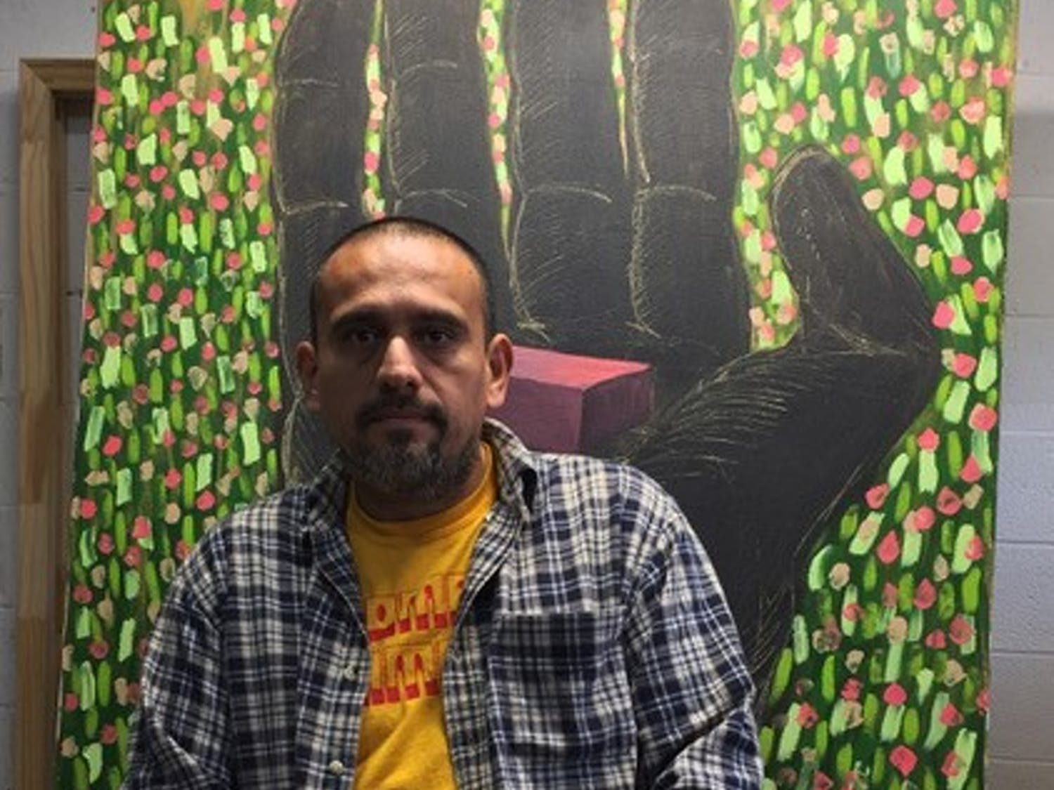 Renzo Ortega sits in his Carrboro studio. He is one of many Orange County artists and musicians who have experienced lifestyle changes as a result of COVID-19. The Orange County Arts Support Fund seeks to assist these artists through community donations. Photo courtesy Renzo Ortega.