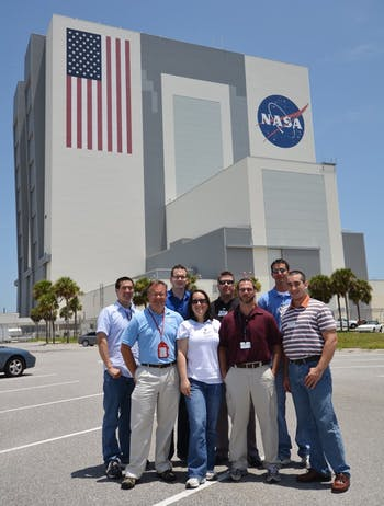 Ted Bateman (second from left) stands with his lab team. Bateman recently sent 30 mice into space on a scientific project.