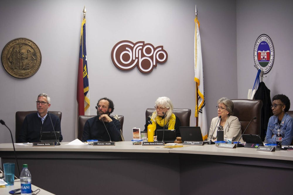 <p>(From left) Town Council Members Damon Seils, Sammy Slade, Randee Haven-O'Donnell and Barbara Foushee and Mayor Lydia Lavelle listen to an ENO Arts Mill proposal in West Hillsborough on Tuesday, Feb. 4, 2020 at the Carrboro Town Hall.&nbsp;</p>