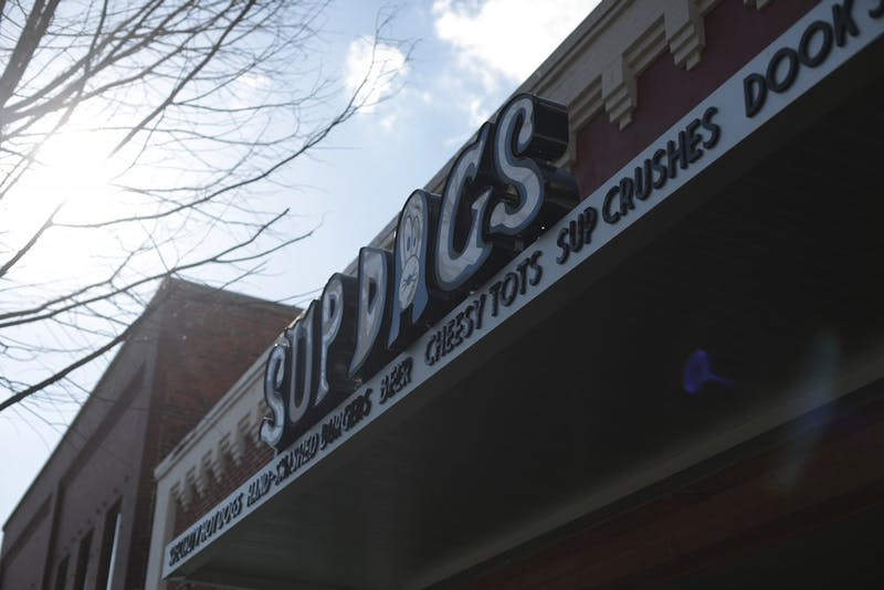 People traditionally gather at Sup Dogs to watch North Carolina men's basketball games.