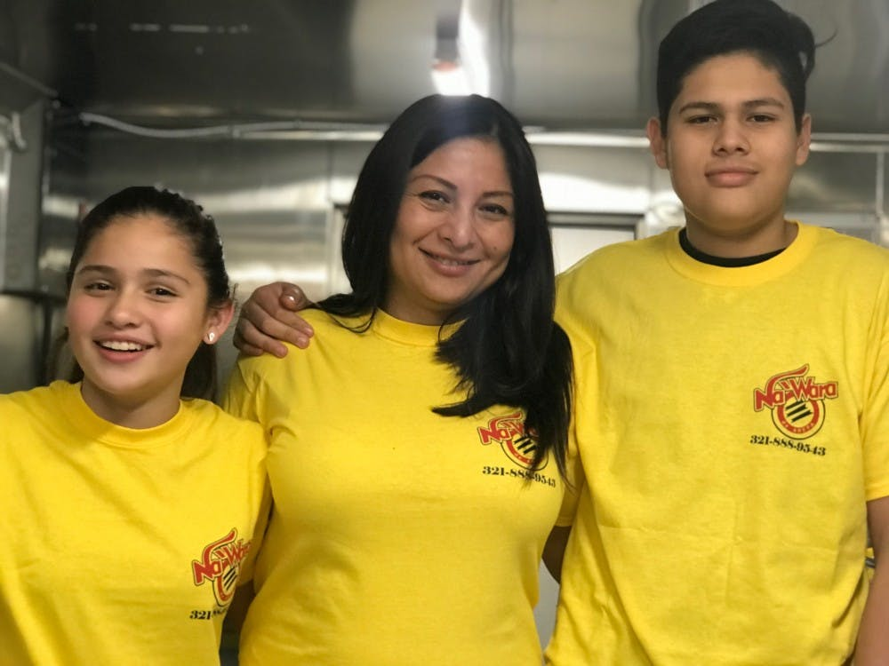 Patricia Fidhel poses with her children, Leonardo and Alexandra, inside their arepa food truck. Photo contributed by David Moncada.