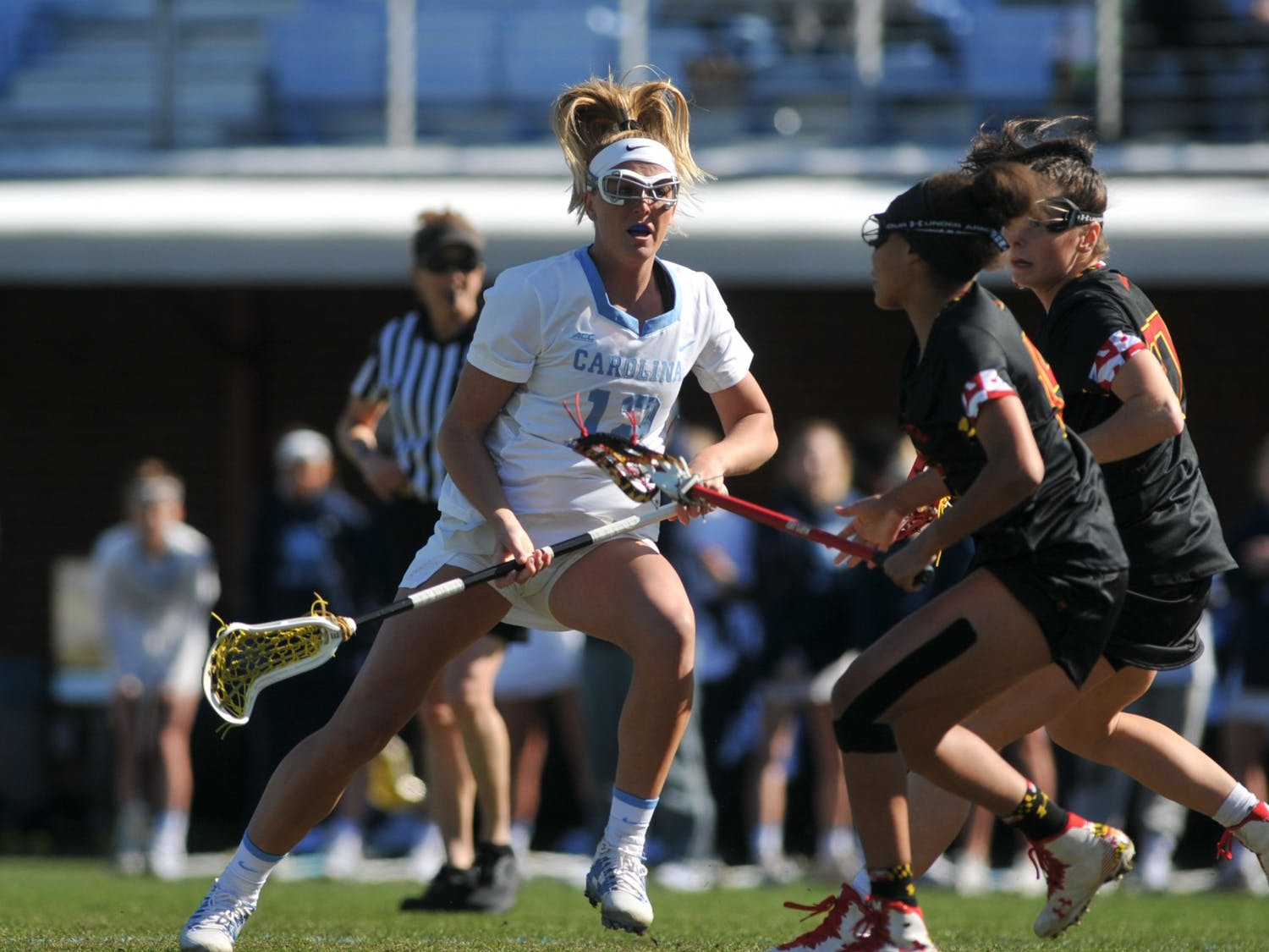 UNC junior midfielder Ally Mastroianni (12) blocks opponents after a pass during the game against Maryland at Dorrance Field on Saturday, Feb. 22, 2020. No 1. UNC won against No 4. Maryland 19-6.