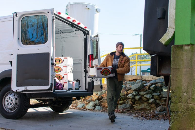 Troy Coll, operations manager of Ungraded Produce, delivers fresh produce from the Raleigh State Farmers Market to Piedmont Food & Agriculture Processing Center, Nov. 29, 2018.