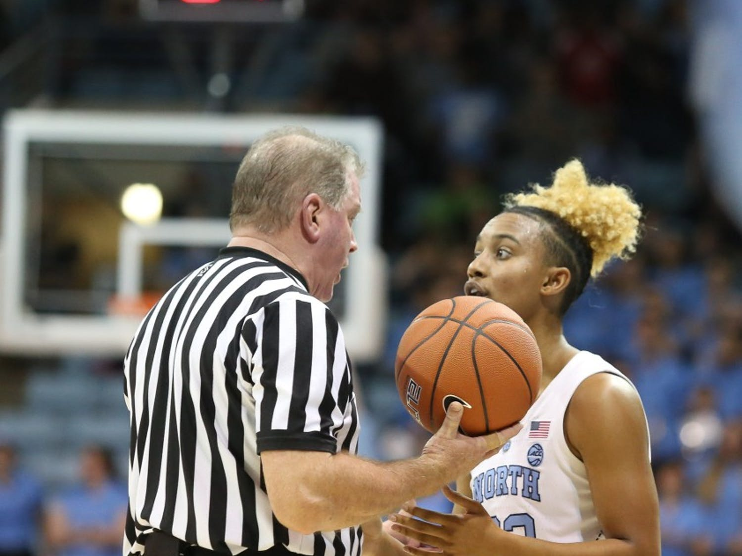 Senior guard Paris Kea (22) talks with a referee during a game against Notre Dame in Carmichael Arena on Sunday, Jan. 27, 2019. UNC won 78-73.