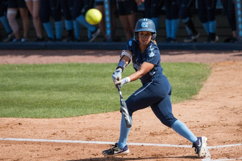 UNC senior outfielder Kiani Ramsey (8) watches the ball after a bat during a double header against the FSU Seminoles at G. Anderson Softball Stadium on Monday, April 15, 2019. The Tar Heels beat the Seminoles in both games.