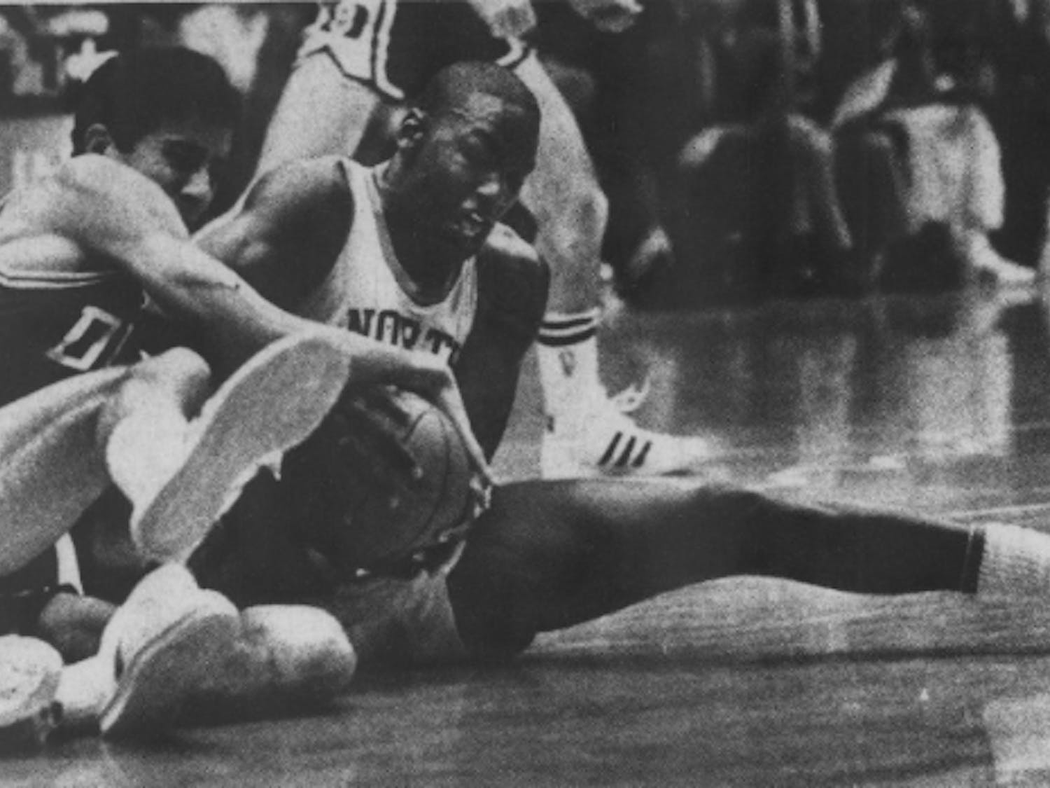 DTH Archive. UNC sophomore Michael Jordan fights with Chip Engelland for possession of the ball in Jan. 22, 1983's 103-82 thrashing of Duke. Photo by Al Steele.
