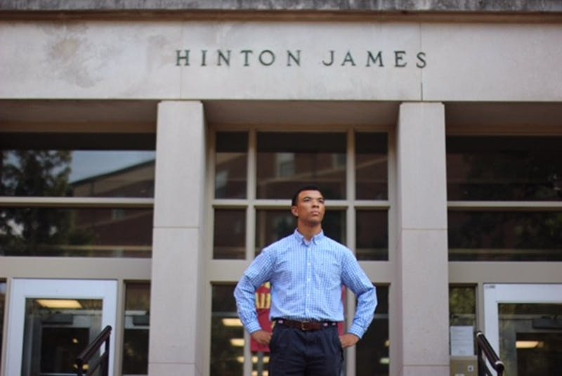 Tarik Woods, a first-year, poses in front of the Hinton James dorm.Photo courtesy of Tarik Woods