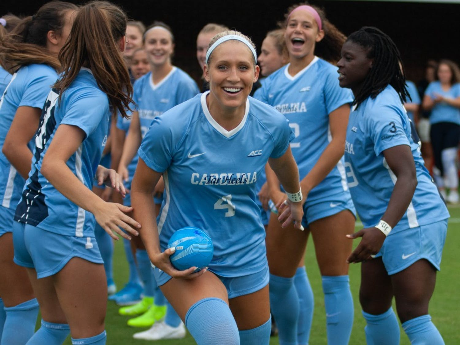 Women's soccer forward, Bridgette Andrzejewski (4), runs out of the tunnel before a game against Duke on Sunday August 25, 2019. UNC beat Duke 2-0.