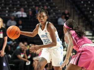Senior guard Shayla Bennett (22) defends the ball from first-year guard Alexandria Scruggs (32) at the Lawrence Joel Veterans Memorial Coliseum  inon Sunday, Feb. 23, 2020. The Tar Heels lost against the Demon Deacons 79-82.