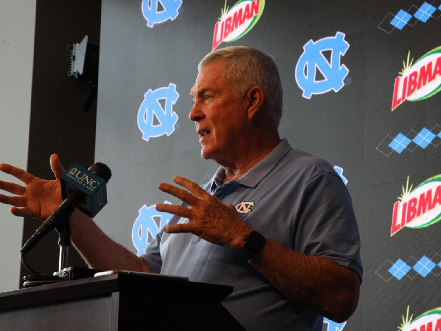 Football's head coach Mack Brown delivers a speech to a press conference on July 31, 2019.