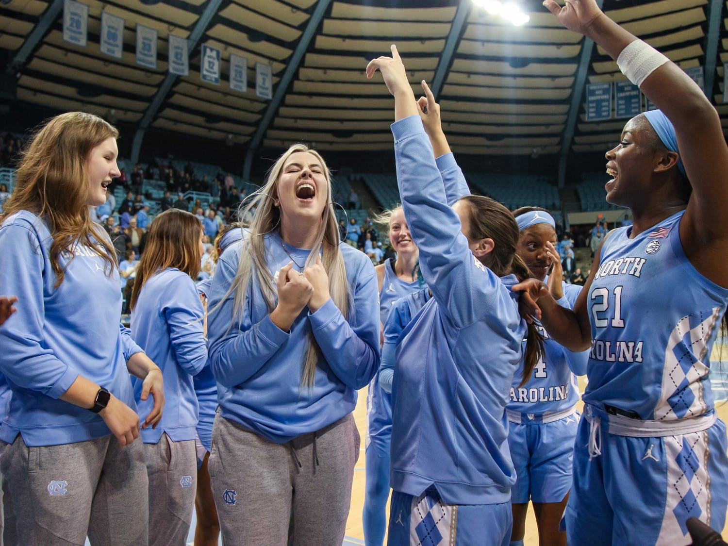 UNC's women's basketball team celebrates their win against NC State on Thursday, Jan. 9, 2020. UNC broke NC State's undefeated streak with a score of 66-60.