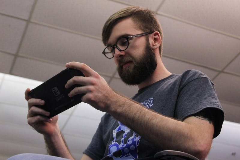 "Shane Steele-Pardue, a senior computer science major, plays on a Nintendo Switch on Monday, March 4, 2019 in the underground area of the Student Union. Steele-Pardue has been co-president of the UNC-CH Esports Club for two years and has involved with the club since his first year at UNC. The UNC-CH Esports Club worked with Carolina Housing to help create the esports gaming area in Craige Resident Hall. Steele-Pardue enjoys esports because they offer a ""cool environment to see the best of the best play."""