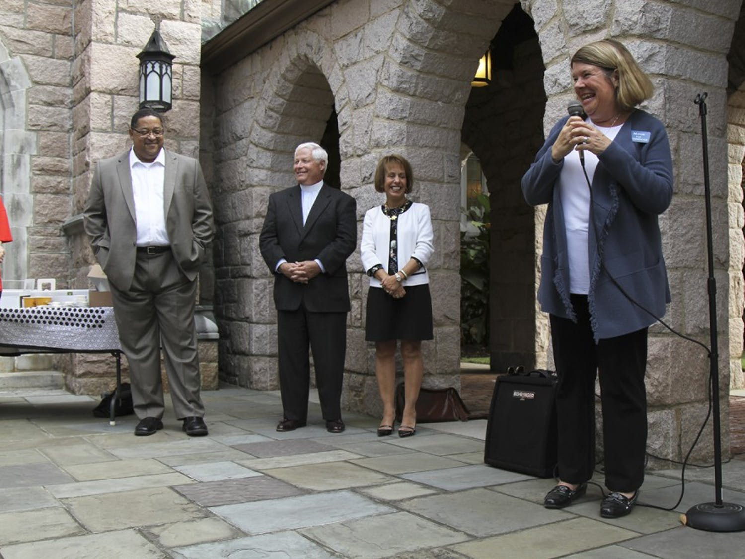 Chapel Hill Mayor Pam Hemminger (right) made statements at the Chapel of the Cross before she casted her vote Thursday.