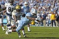 Former North Carolina running back T.J. Logan (8) dives into the end zone against Georgia Tech in 2016.