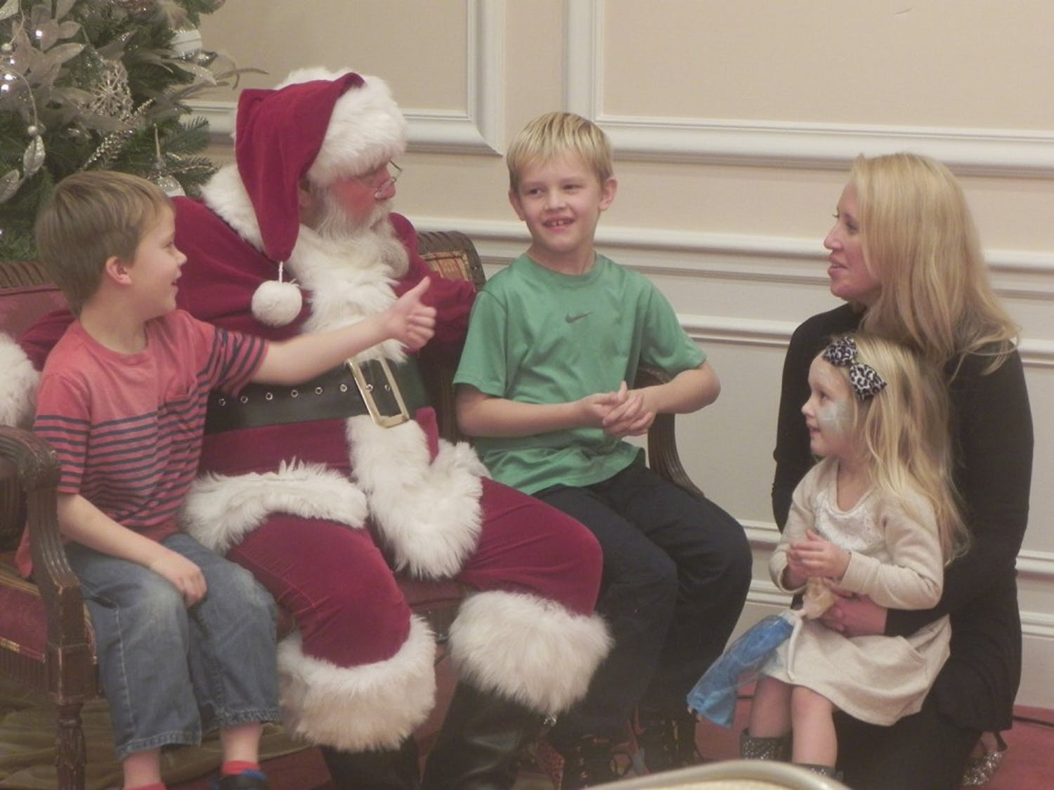 Jackson (left), 6, and Lucas Stansell (right), 9, meet with Lee Humphries, a professional Santa.