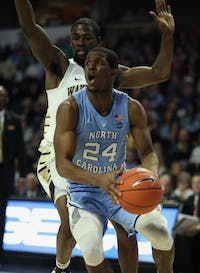 Senior guard Kenny Williams (24) prepares to take a shot in No. 8 UNC's 95-57 win over Wake Forest on Saturday, Feb. 16, 2019 at Lawrence Joel Veterans Memorial Coliseum.