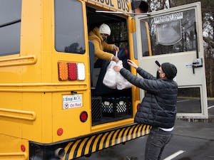 Yasmin Cornish, a bus driver for Chapel Hill-Carrboro City Schools, provides bags of meals at Berkshire 54 Apartments on Friday, Feb. 12, 2021. Food for Students provides meals for CHCCS students whose families have been financially affected by the COVID-19 pandemic.