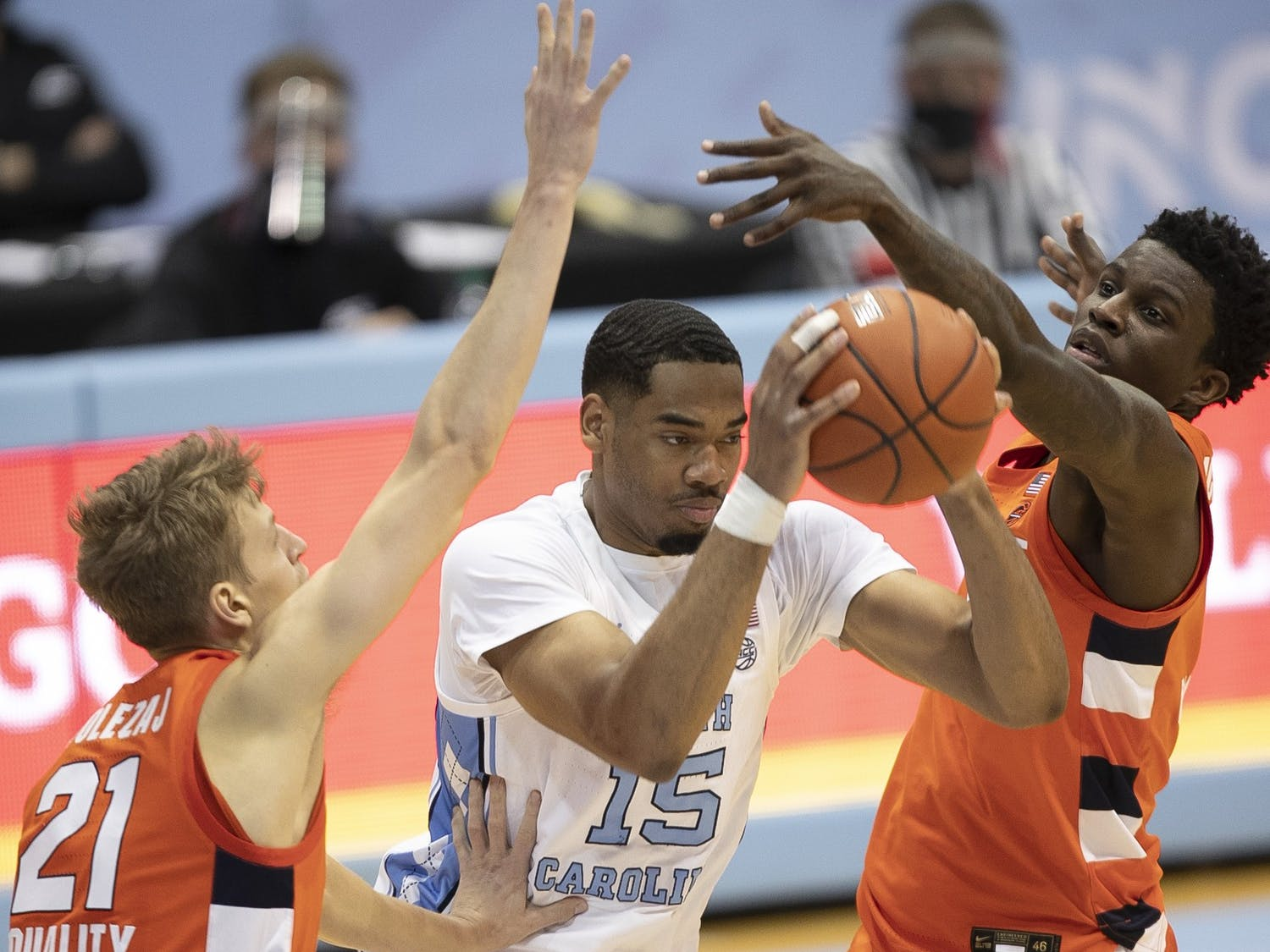 North Carolina's Garrison Brooks (15) is trapped by Syracuse's Marek Dolezaj (21) and Kadary Richmond (3) during the second half on Tuesday, January 12, 2021 at the Smith Center in Chapel Hill, NC. Photo courtesy of Robert Willett.