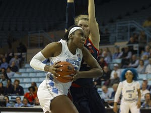 UNC junior center Janelle Bailey (30) attempts to make a goal. The Tar Heels played against Virginia Cavaliers on Thursday, Jan. 30, 2020 in Carmichael Arena. UNC won 78-68.