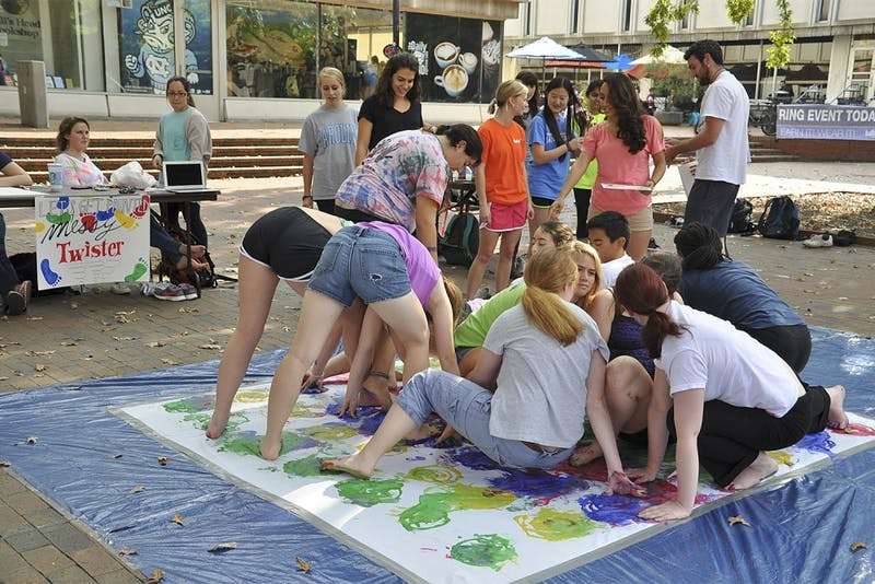 "ArtHeels, an organization of students that participates in art-therapy for mental illnesses, held a game of ""Messy Twister"" with colorful paint on Wednesday afternoon in the pit for students to de-stress during midterms."