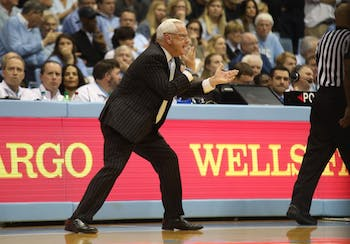 Head Coach Roy Williams encourages players during the final home game against Duke in the Smith Center on Saturday, March 9, 2019. UNC defeated Duke 70-79 on Senior Night to finish the season as ACC regular season champions.