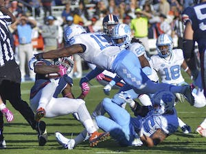 Donnie Miles (15) tackles a Virginia player. UNC defeated UVA 35-14 on Saturday, October 23.