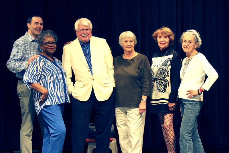 Participants in the Fashion Show at the Seymour Senior Center pose for a picture after a dress rehearsal.