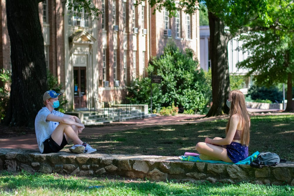 <p>Students enjoy the outdoors while wearing masks and staying social distant at Polk Place on Sunday, Sept. 6, 2020.</p>