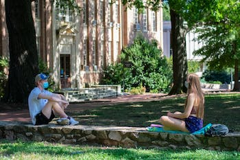 Students enjoy the outdoors while wearing masks and staying social distant at Polk Place on Sunday, Sept. 6, 2020.