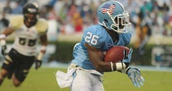 UNC running back Giovani Bernard, sporting a patriotic helmet for Military Appreciation Day, runs the ball against Idaho. Bernard had two touchdowns.