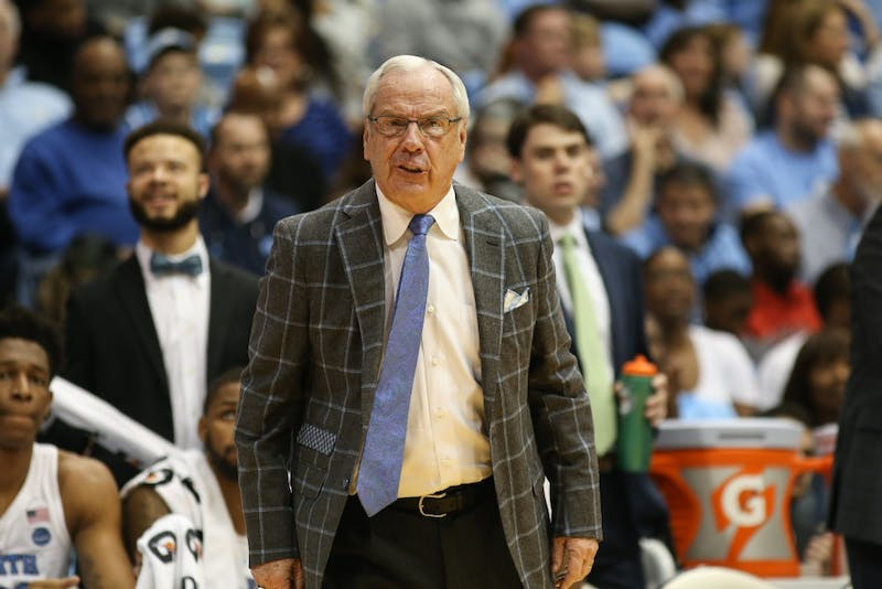 Head coach Roy Williams yells at team during the first half of Saturday's game against Davidson. Davidson had the lead and UNC lead with turnovers.