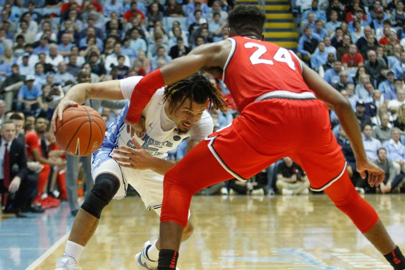 UNC freshman guard Cole Anthony (2) drives against Ohio State senior forward Andre Wesson (24) in the game against Ohio State in the Smith Center on Wednesday, Dec. 4, 2019. UNC lost to Ohio State 74-49.