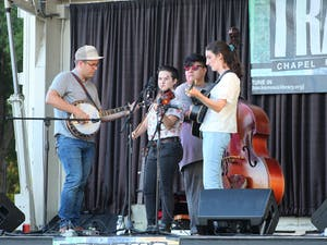 The bluegrass band Hard Drive performs at the Tracks Music Series concert on September 9th, 2021. The Tracks Music Series is a free event that takes place every Thursday evening during September at University Place and features local Chapel Hill musicians.