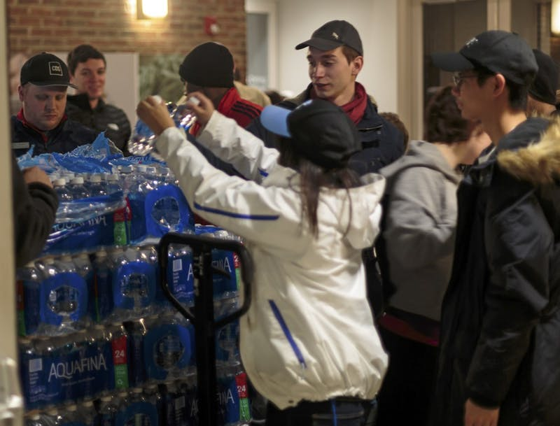 Carolina Dining Service employees hand out water to students during the water crisis.