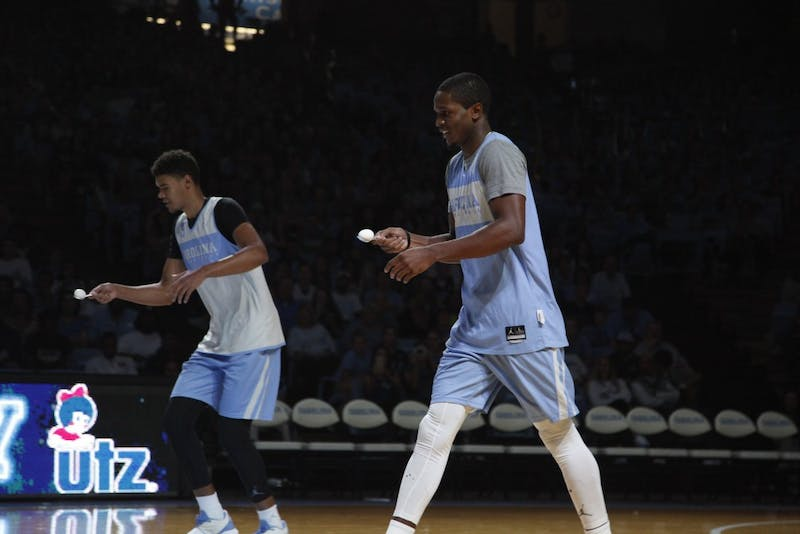 Cam Johnson and Kenny Williams compete against each other during an egg race on Friday Oct. 11 at Late Night with Roy.