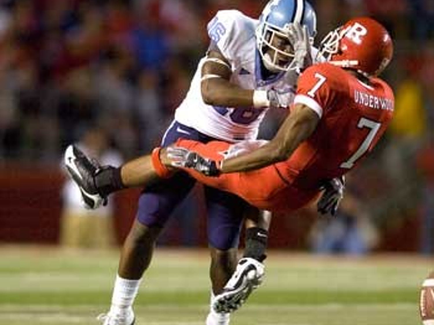UNC corner Kendric Burney (16) managed a big hit on Rutgers? Tiquan Underwood in Thursday?s game by not ?biting the cheese.?