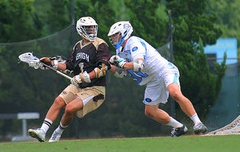 UNC defenseman Jordan Smith holds off a Lehigh attackman in one of the Tar Heels' best defensive performances all season.