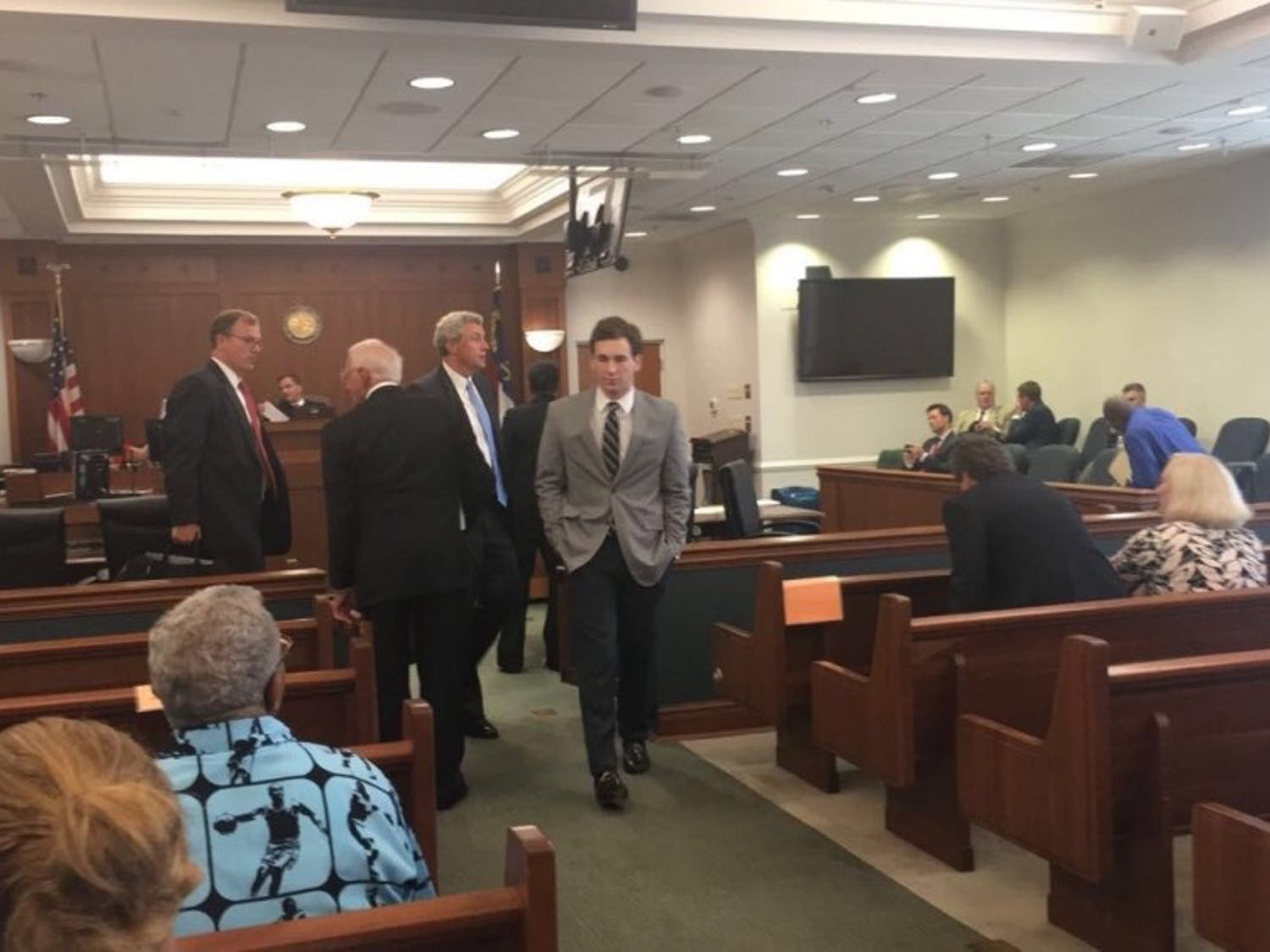 Chandler Kania leaves his pre-trial hearing at the Orange County Courthouse on Aug. 16. Photo by Sara Kiley Watson.